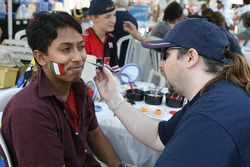 Fans at the circuit get their faces painted