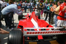 Fans at the circuit take pictures of a Ferrari F1 car