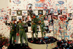 LM GT1 podium: class winners Pedro Lamy and Stéphane Sarrazin, with second place Ron Fellows and Johnny O'Connell, and third place Tomas Enge and Darren Turner