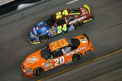 Tony Stewart leads Jeff Gordon