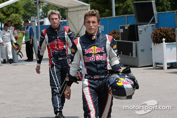 Christian Klien and Scott Speed on the way back to the paddock
