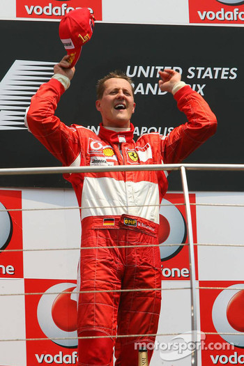 Podium: race winner Michael Schumacher celebrates