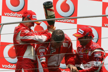 Podium: champagne for Michael Schumacher, Felipe Massa and Ross Brawn