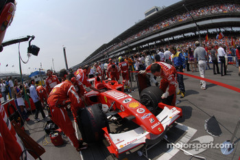 Ferrari team members on the starting grid