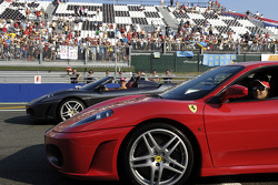 Michael Schumacher and Felipe Massa drive Ferrari F430 cars