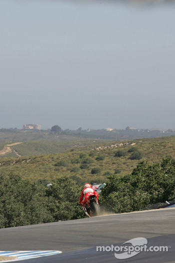 Loris Capirossi going a little wide at the corkscrew