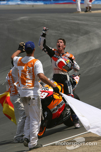 Race winner Nicky Hayden celebrates