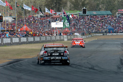 Mark Skaife takes the chequered flag