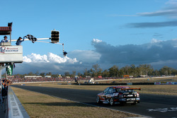 Garth Tander takes the chequered flag