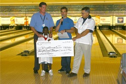 Jeff Gordon Foundation bowling tournament: Jeff Gordon presents a donation to charity