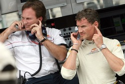 Sporting director Christian Horner and David Coulthard at the pit perch