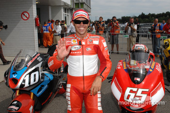 Second fastest qualifier Loris Capirossi celebrates