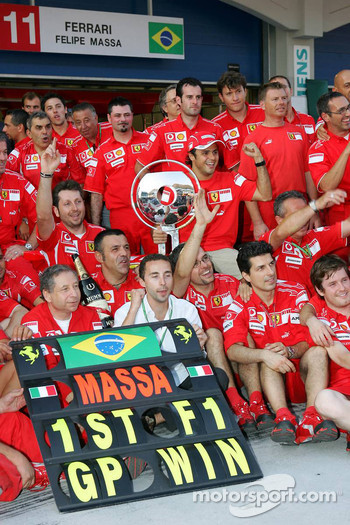 Race winner Felipe Massa celebrates with Jean Todt, Nicolas Todt, Michael Schumacher and Scuderia Ferrari team members