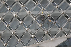 Workers clean the windows of the Yas Marina hotel
