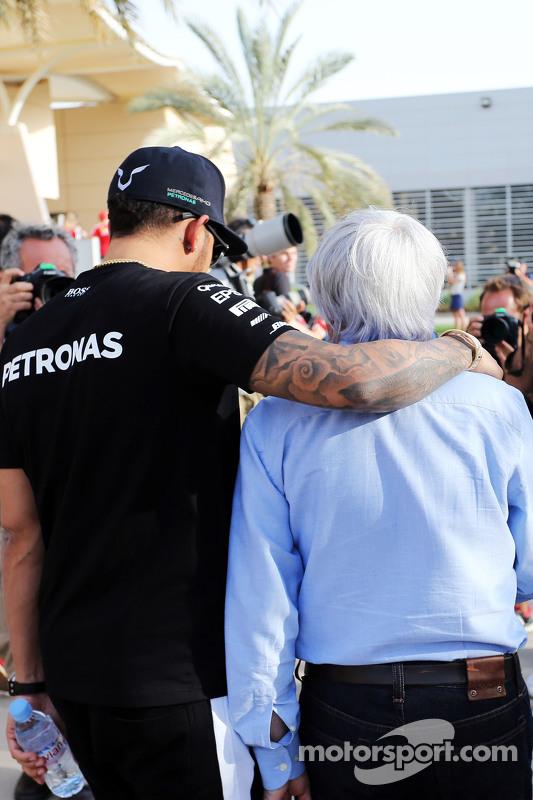 (L to R): Lewis Hamilton, Mercedes AMG F1 with Bernie Ecclestone