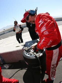 Chip Ganassi crew member gets ready for a pitstop