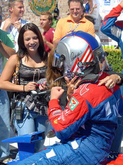 Marissa and Sandy Andretti greet Marco in Victory lane