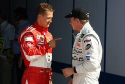 Pole winner Kimi Raikkonen with Michael Schumacher