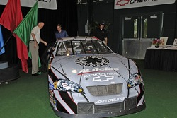 Chevrolet General Manager Ed Peper, ACDelco/GM Goodwrench's Jim Moloney and NASCAR Busch Series driver Clint Bowyer unveil the No. 2 ACDelco Chevrolet Monte Carlo featuring a Red Hot Chili Peppers paint scheme