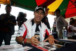 Takuma Sato signs autographs for the fans