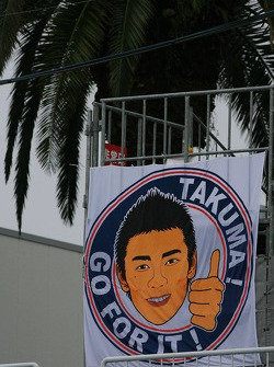 Takuma Sato banner at the circuit