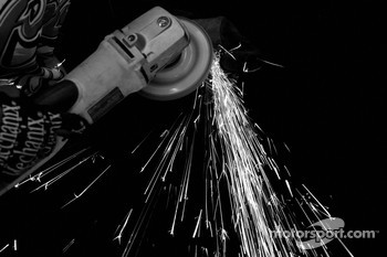 Sparks fly as a Coors Light Dodge crew member works on a piece of metal