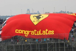 A big Ferrari flag in the grandstand
