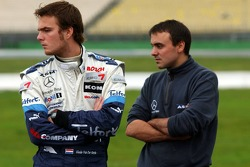 F3 driver Giedo van der Garde looks at DTM garage activity
