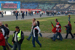 Crowd and fans run on the track to the podium ceremony