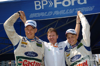 Winners Mikko Hirvonen and Jarmo Lehtinen celebrate