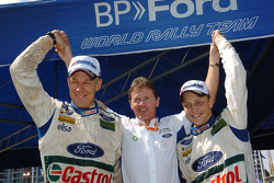 Winners Mikko Hirvonen and Jarmo Lehtinen celebrate