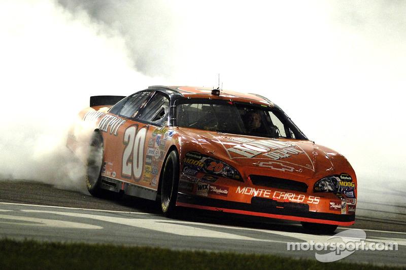 Race winner Tony Stewart celebrates