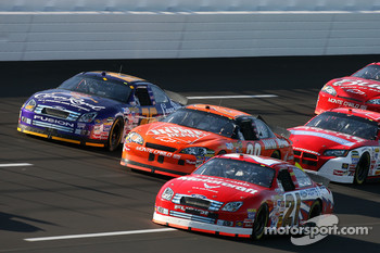 Ken Schrader leads a group of cars