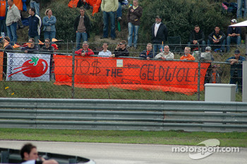 Dutch fans with a banner saying Jos Verstappen is a golddigger