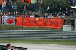 Dutch fans with a banner saying Jos Verstappen is a golddigger