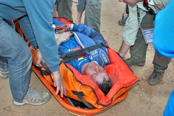 Serguey Savostin on a stretcher after the crash of the Kamaz-Master #500