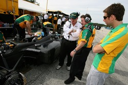 Will Power looks on as Simon Pagenaud gets ready