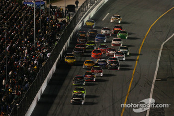 Mark Martin leads Kyle Busch while the field battle hard