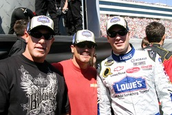 Brothers Marcus and Brian Giles of the San Diego Padres pose for a photo with Jimmie Johnson