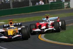 Giancarlo Fisichella, Renault F1 Team, R27 leads Jarno Trulli, Toyota Racing, TF107