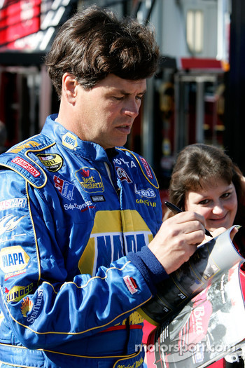 Michael Waltrip signs autographs