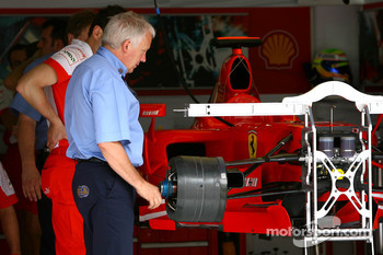 Charlie Whiting, FIA Safety delegate, Race director and offical starter, examines the Scuderia Ferrari F2007