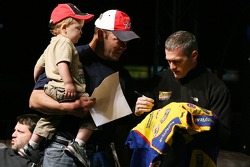 A view of Bobby Labonte signing an autograph for a fan, during the Fandango Exclusive Season Ticket Holders party