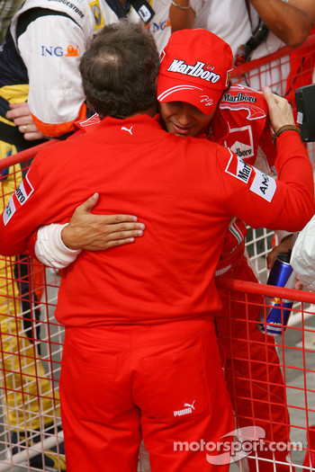 Pole winner Felipe Massa celebrates with Jean Todt
