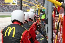 Team members watch the race