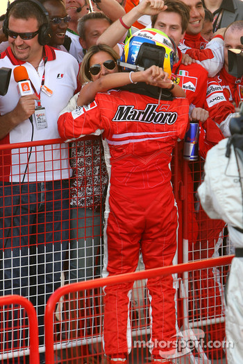 Race winner Felipe Massa celeberates with girlfriend Rafaela Bassi