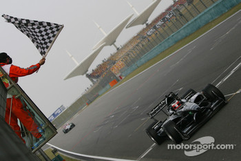 Jonny Reid, Driver of A1Team New Zealand takes the flag