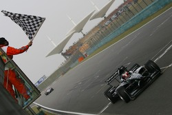Jonny Reid, Driver of A1Team New Zealand takes the flag