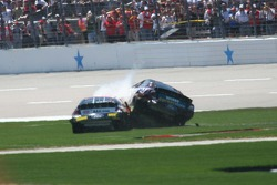Ricky Rudd drives over Regan Smith