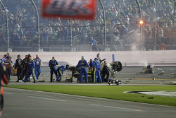 Crews check on the wrecked car of Austin Dillon, Richard Childress Racing Chevrolet